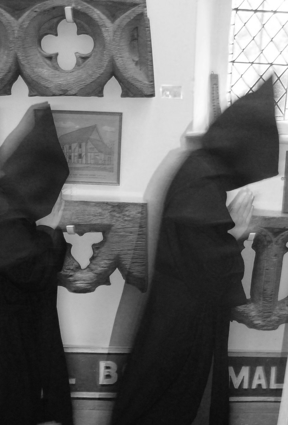 Two young Benedictine monks appearing on the upstairs corridor